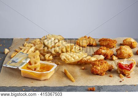 Quick Convenient Fast Food Image With Close Up Selective Focus Of  Bitten Deep Fried Chicken Nuggets