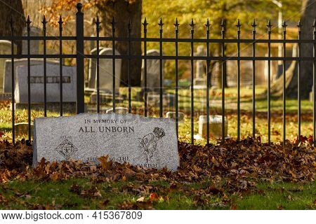 Rockville, Md, Usa, 11/16/2020: A Tombstone In The  Grave Yard By Historic Saint Mary's Church With