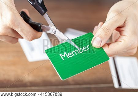 Close Up Isolated Image Of A Young Woman Cutting A Membership Card. Customizable With Copy Space On