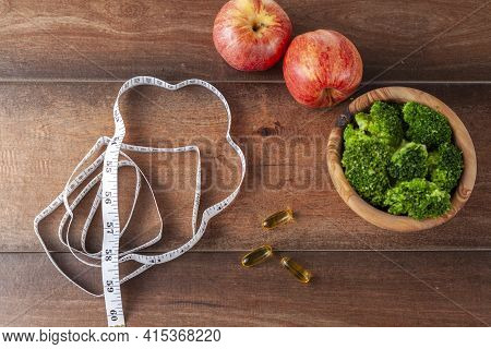 A Fitness, Getting In Shape, Diet, Healthy Living Concept Image With A Close Up Top View Of A Measur