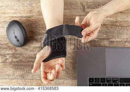 Chronic Trauma To The Wrist Joint  In People Using Computer Mouse May Lead To Disorders That Cause I