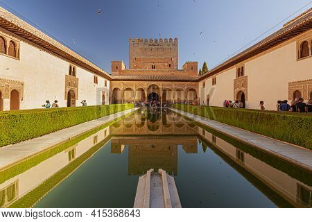 Granada, Spain 07-12-2010: Alhambra Palace Complex Reflection Pool With The Reflection Of The Palace
