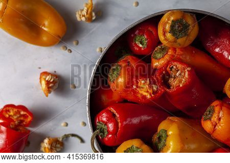 Making Of Stuffed Bell Peppers Using Rice, Meat Mixture Based Filling. Peppers Were Cut At The Top A