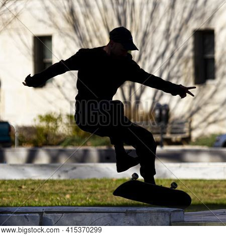 Washington Dc, Usa 11.28.2020: Backlit Close Up Image Showing The Silhouette Of A Skater In The Air