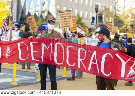 Washington Dc, Usa 11/06/2020: A Group Of Democratic Socialists Wearing Rose Handshake Masks Are Rma