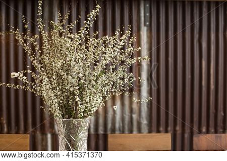Spiraea Flowers In A Glas Vase On A Table In A Cafe