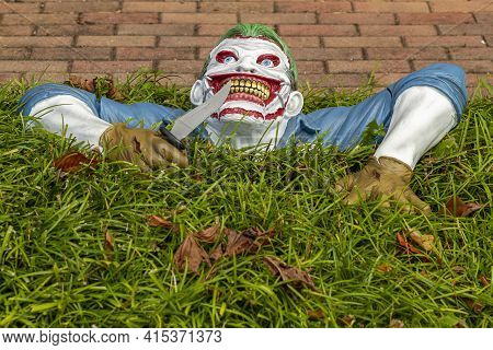 A Creepy But Original Halloween Decoration Put In The Front Yard Of A House. A Plastic Model In Shap