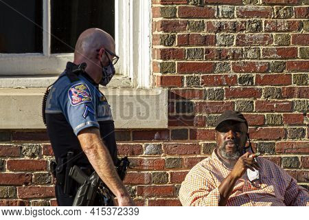 Ellicott City, Md, Usa 10/07/2020: A White Police Officer With Shaved Head Who Is Wearing  Short And