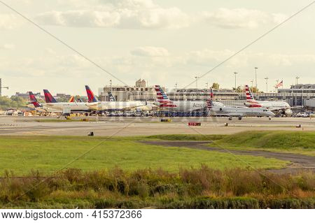 Washington Dc, Usa 10/02/2020: Image Of Planes From Different Airlines Waiting At Gates For Loading