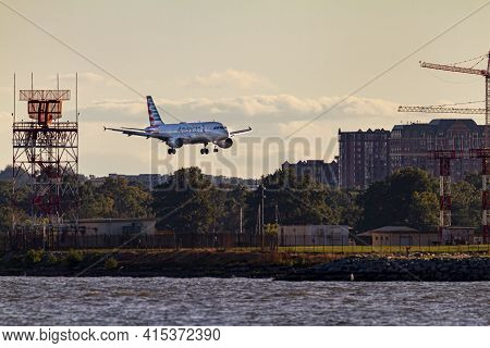 Washington Dc, Usa 10/03/2020: An Airbus A321 Airplane By American Airlines Is Landing Descending To
