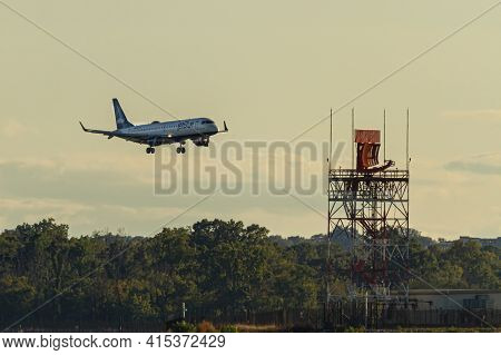 Washington Dc, Usa 10/03/2020: An Airbus A321 Airplane By Jet Blue Airlines Is Landing Descending To