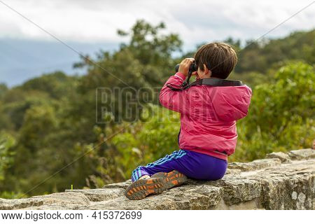 Shenandoah Valley, Va, Usa 09/27/2020: A Little Caucasian Child Wearing A Coat And Tracking Pants Is