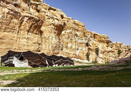 A Bedouin Tent Made Of Goat Hair Set Up In The Desert Landscape Of Jordan, Near Petra. Image Feature
