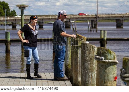 Chestertown, Md, Usa, 08/30/2020: A Middle Aged Rocker Man Is Standing On The Dock By Chester River.