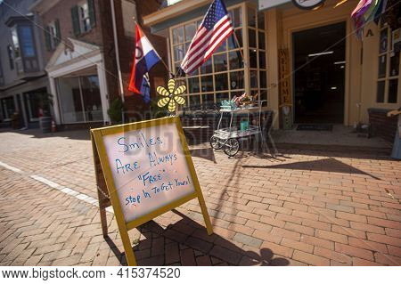 A Free Standing White Board Placed Outside Of A Vintage Shop In Chestertown, Maryland Has A Hand Wri