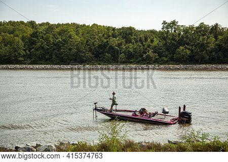 Chesapeake City, Md, Usa 08/25/2020: An Elderly Couple Is Seen On A Red Phoenix Bass Fishing Boat In