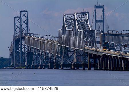Day Time Telephoto Long Exposure Image Showing The Rush Hour Traffic On Chesapeake Bay Bridge. It Fe