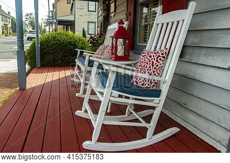 Chesapeake City, Md, Usa 08/25/2020: Close Up Image Of Two White Wooden Traditional Rocking Chairs O
