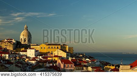 A Sunset View Of The Historic Alfama District Of Lisbon, Portugal. Image Features The National Panth