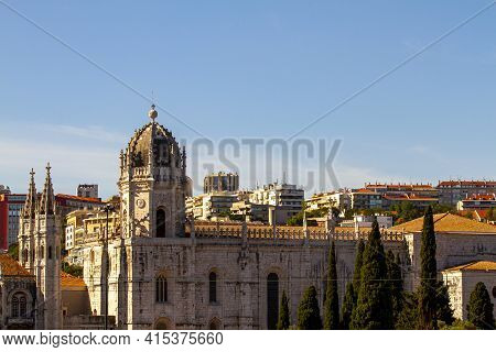 Cityscape Of Lisbon, Portugal As Viewed From The Banks Of Tagus River. Image Features Rooftops And E
