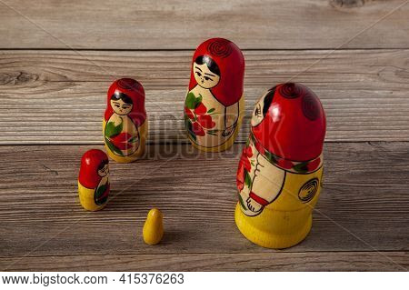 A Close Up Isolated Image Of A Set Of Handmade Russian Matrushka Dolls That Are Lined Up Around A Ci