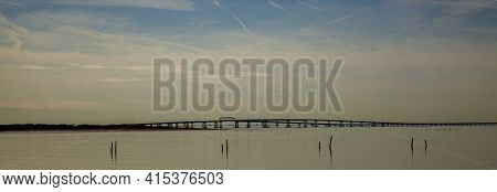 A Sunset Panorama Featuring The Silhouette Of  Lucius J. Kellam Jr. Bridge Tunnel, Better Known As T