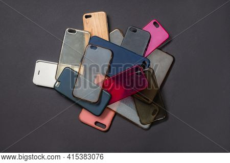 Pile Of Multicolored Plastic Back Covers For Mobile Phones On Black Background