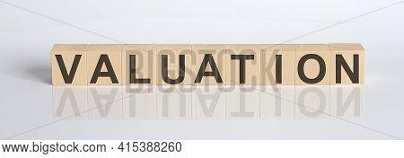 Valuation Word Written On Cube Shape Wooden Blocks On White Background
