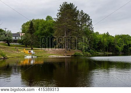 Seaplane Moored Near The Shore Of A Mountain Lake. Adirondacks, Ny