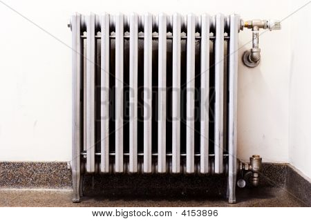 Closeup Of An Old Radiator With A New Thermostat