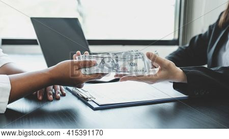 A Businesswoman Handed Bribe Money To The Government Officials To Sign A Business Agreement Concept