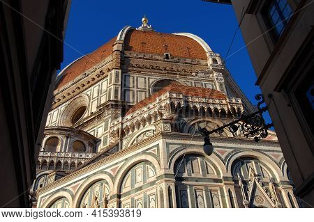 View Of Santa Maria Del Fiore (st Mary Of The Flower) In Florence From A Narrow Lane, Built By Itali