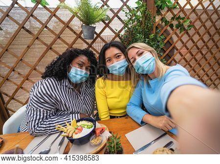 Multiracial Friends Wearing Face Mask While Taking Selfie With Smartphone Cam In Coffee Brunch Resta
