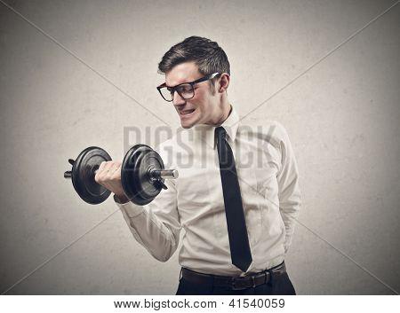 Office worker raising a dumbbell
