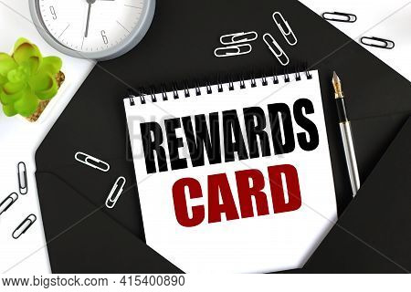 Reward Card. . Text On A Sheet Of Notepad On A Black Envelope On A Light Background