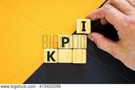 Kpi, Key Performance Indicator Symbol. Wood Cubes With Words 'kpi, Key Performance Indicator' On Yel