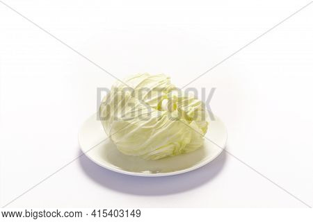 Piece Of Fresh Ripe Savoy Cabbage Isolated On White Background.