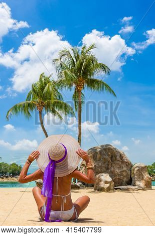 Woman at the beach in Sentosa island in Singapore