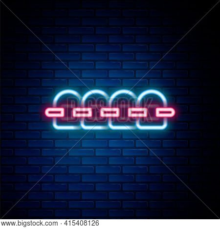 Glowing Neon Line Teeth With Braces Icon Isolated On Brick Wall Background. Alignment Of Bite Of Tee