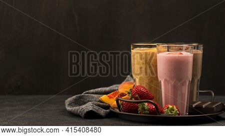 Selection Milkshake Glasses With Fruits Chocolate. High Quality And Resolution Beautiful Photo Conce