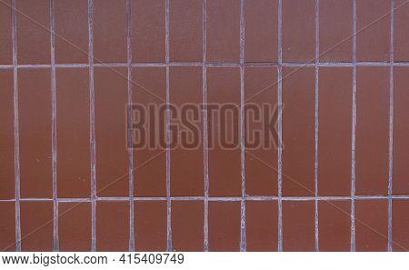 Background Of Brown Ceramic Tiles. Full Frame Image Of Brown Ceramic Tile Wall Background