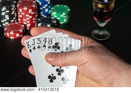 Poker Cards Flush Combination. Close Up Of A Gambler Hand Is Holding Playing Cards And Sigar In Poke