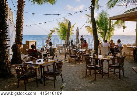 Curacao, Netherlands Antilles March 2021, People Dining On The Beach Curacao Caribbean Island, Color