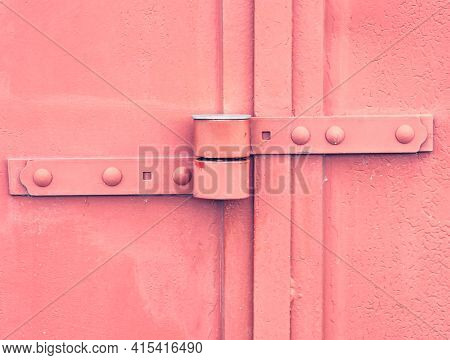 Safety Anti Thef Latch Lock On Warehouse Door. Industrial Kind Of Gate Door With Obsolete Red Paint.