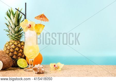 Summer Tropical Cocktail Drink, Fruits And Flowers, Blue Sea Background, Copy Space. Summer Vacation