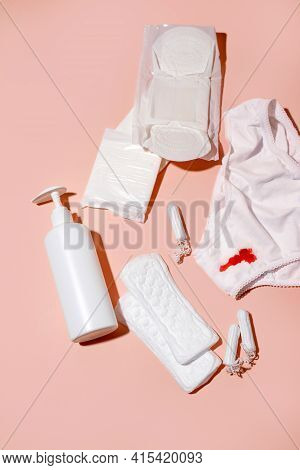 White Cotton Panties For Women With Traces Of Fresh Red Blood And Care Products. Concept Of Menstrua
