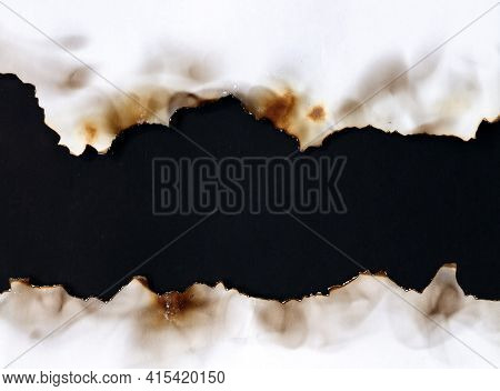Burnt Old Torn White Paper On Black Background With Copy Space
