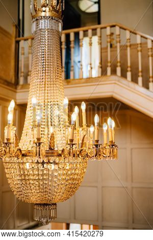 Antique Large Crystal Chandelier With Pendants And Candles.