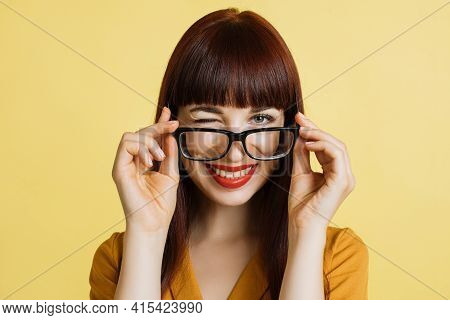 Eye Glasses, Spectacles Promotion, Optics Ad. Closeup Portrait Of Charming, Positive Young Woman In