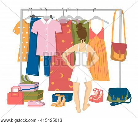 The Girl In Underwear Stands In Front Of The Hanger And Chooses Clothes. Young Woman Trying To Choos
